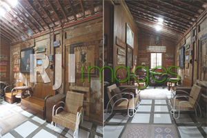 Area ruang tamu dengan kursi rotan klasik dan Paduan desain bangunan tradisional